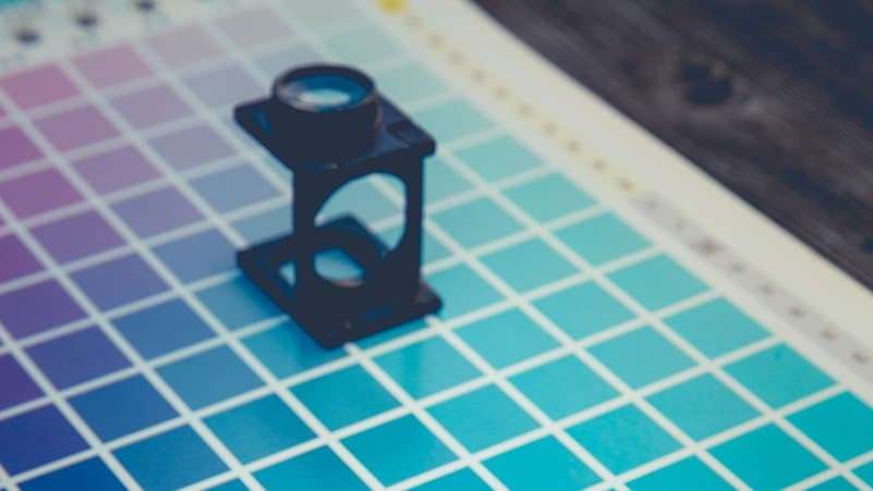 Printers ink swatch with magnifying glass
